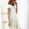 SCANDEZZA Beżowa sukienka boho z ozdobnym wykończeniem - zdjęcie 1