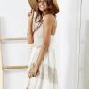 SCANDEZZA Beżowa sukienka boho z ażurowymi wstawkami - zdjęcie 1