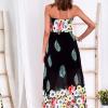 SCANDEZZA Czarna długa sukienka z kolorowymi kwiatami - zdjęcie 1