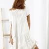 SCANDEZZA Beżowa sukienka boho z ozdobnym wykończeniem - zdjęcie 4