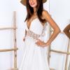 SCANDEZZA Beżowa sukienka z ozdobnym dekoltem z tyłu - zdjęcie 1
